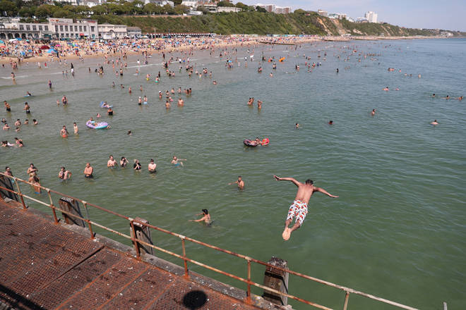 A swimmer jumps into the sea in Bournemouth