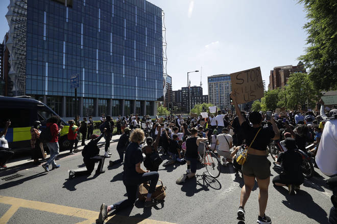 File photo: Demonstrators kneel down outside the U.S. embassy after people marched there from Trafalgar Square in central London on Sunday