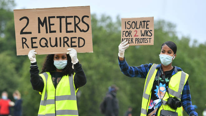 Protesters reminded each other to keep a 2m distance to adhere to coronavirus guidelines