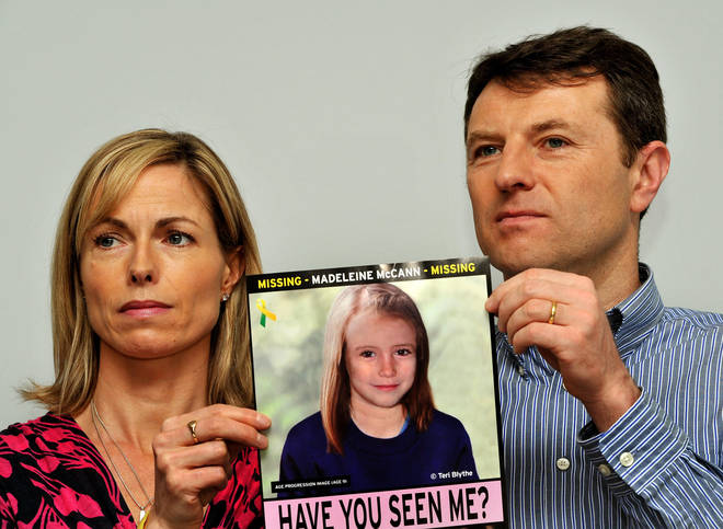 Gerry and Kate McCann whose daughter Madeleine disappeared from a holiday flat in Portugal in 2007 at a press conference in London where they hold an image of what Madeline might look like as an older girl