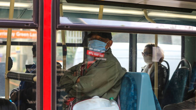 A passenger on a London bus wearing a protective mask as a preventive measure during COVID-19 outbreak