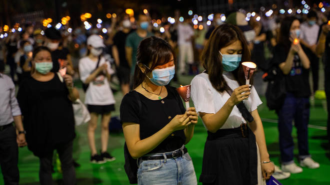 Tens of thousands gathered in Hong Kong for the vigil, defying a ban