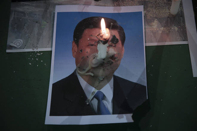 One candle was seen burning on a picture of Chinese President Xi Jinping