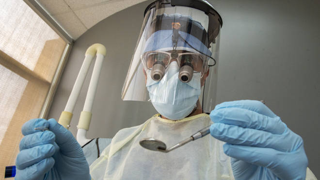 A dentist in full PPE (file image)