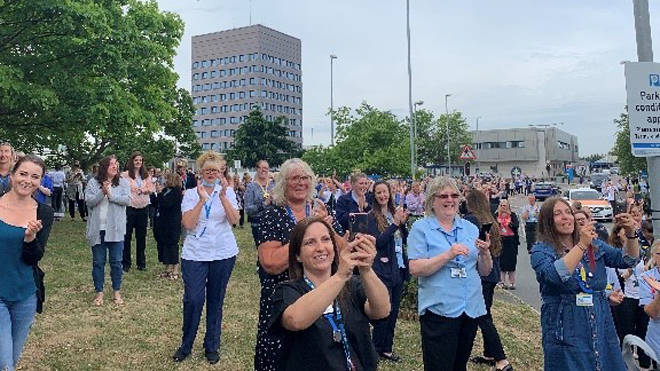 Hundreds of hospital workers turned out to applaud Colin