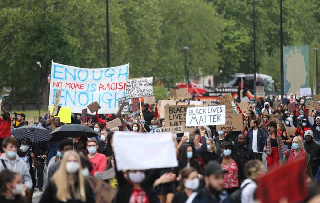 A crowd of participants during a Black Lives Matter march down Park Lane