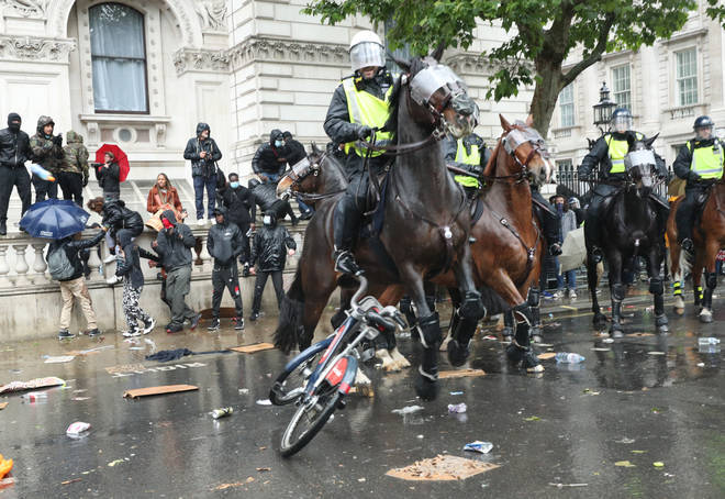 Mounted officers clashed with protesters on Whitehall