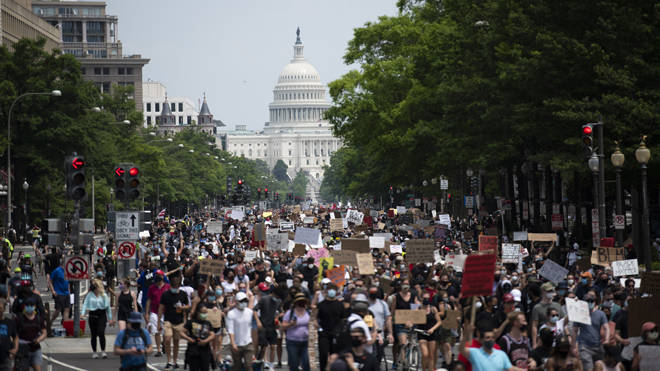 Protesters march near the Capitol Hill during a demonstration over the death of George Floyd