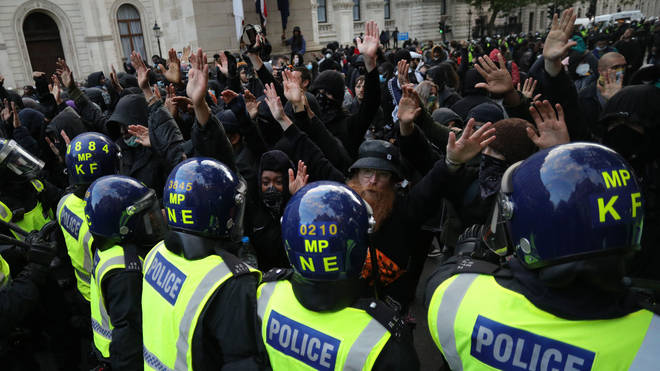 Protesters pictured against a line of police officers