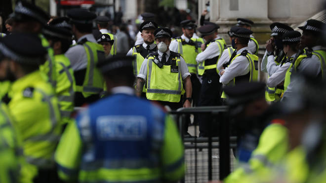 Police at Downing Street were confronted by protesters for a second evening running