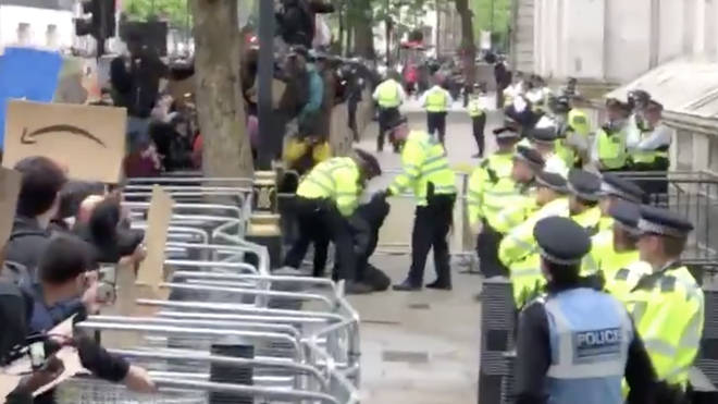 One person was arrested outside Downing Street after climbing over the barriers
