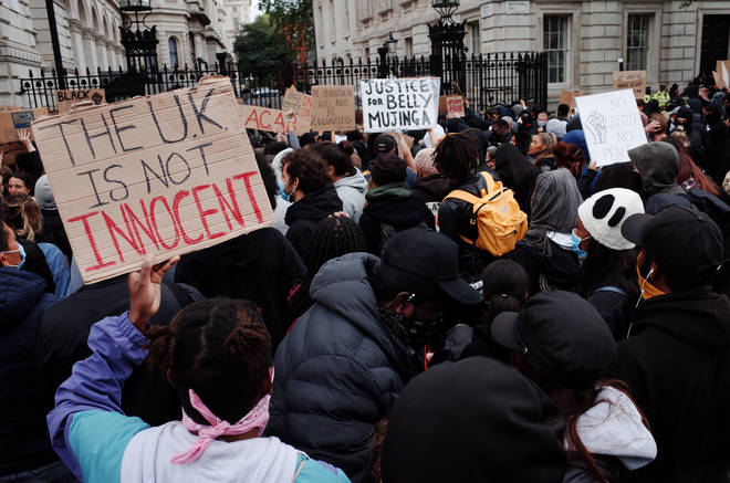 Protesters gather outside Downing Street