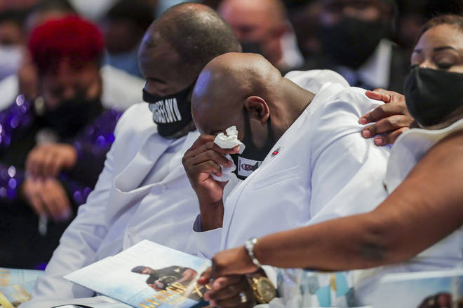 "Rodney Floyd puts his arm around his brother Philonise Floyd as they listen to the song ""Oh, How Precious"" sung during the funeral for their brother, George"