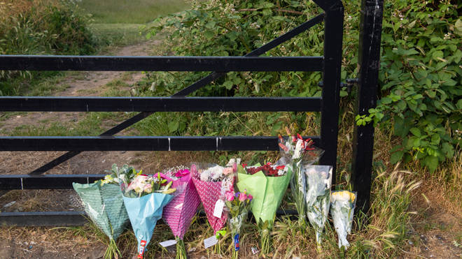 Tributes at the scene at an entrance to Fryent Country Park, in Wembley