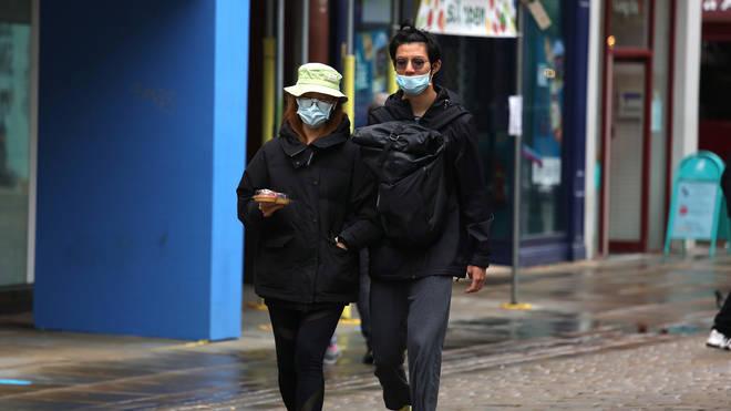 Members of the public wear masks on Market Street, Manchester
