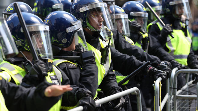 Police and protesters clashed in central London today