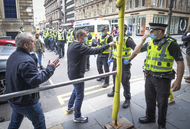 Some protesters clashed with police in Glasgow on Sunday