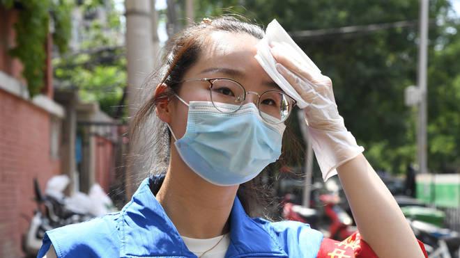 A fresh wave of coronavirus cases has forced Beijing authorities to shut schools