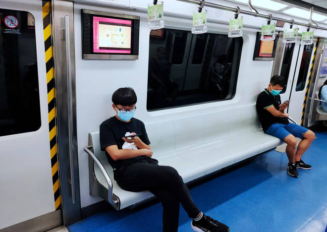 Residents of Beijing who use public transport will need to wear face masks