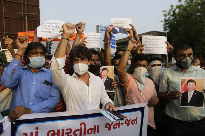 Indians shout slogans during a protest against China in Ahmedabad, India