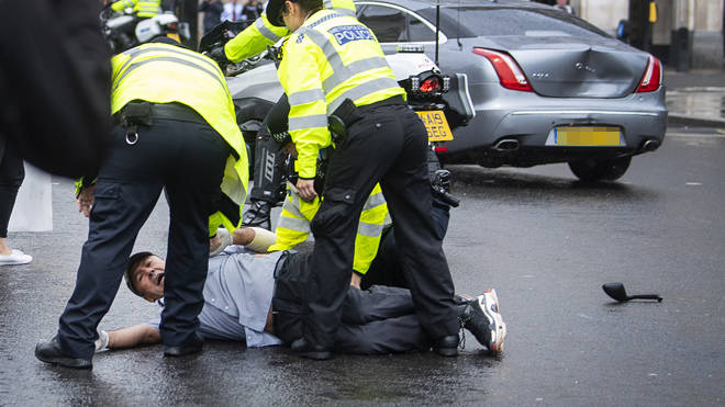 A protester leapt in front of the Prime Minister's official car