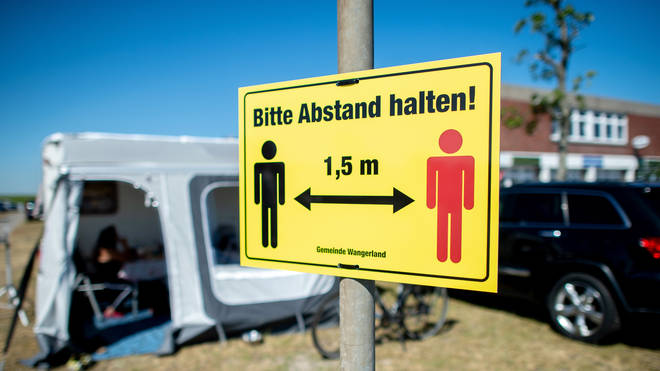 """A sign at a German campsite reads """"Please keep your distance"""""""