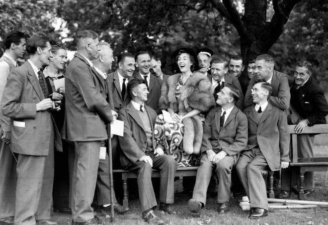 Vera Lynn with ex-servicemen during a Garden Party held by the Queen at Buckingham Palace in 1950