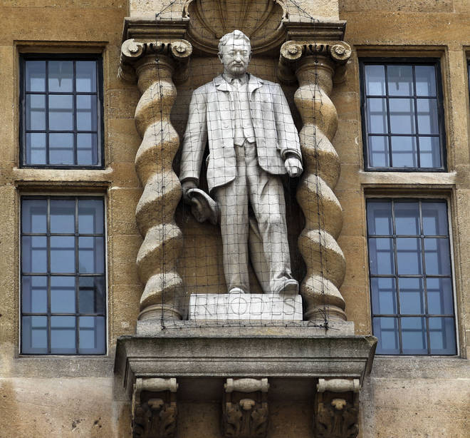 The Rhodes statues stands outside Oriel College, Oxford
