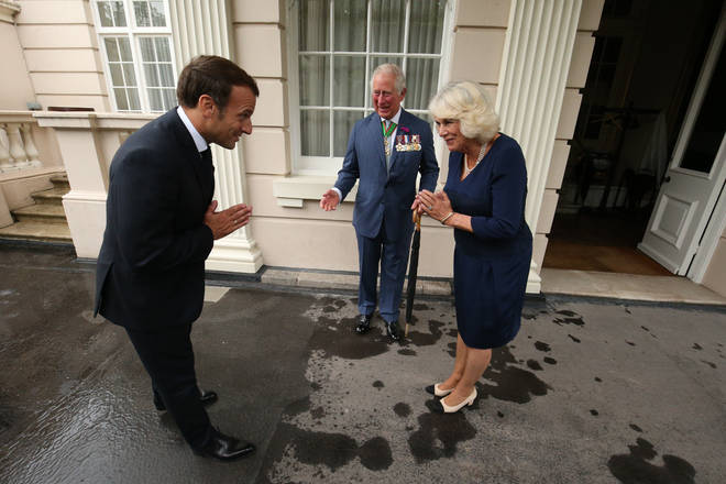 The Prince of Wales and the Duchess of Cornwall greet French president Emmanuel Macron with a namaste gesture at Clarence House
