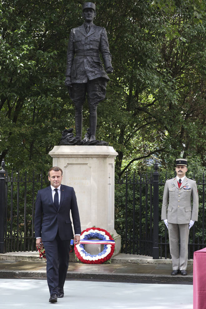 French President Emmanuel Macron lays a wreath at the foot of the statue of Charles de Gaulle