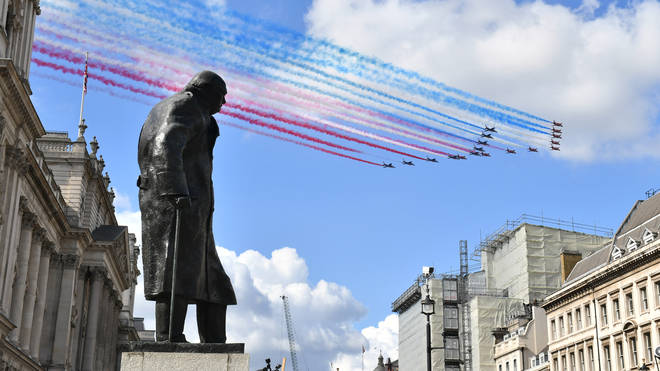 The statue of Britain's wartime leader in Parliament Square was uncovered on Wednesday evening