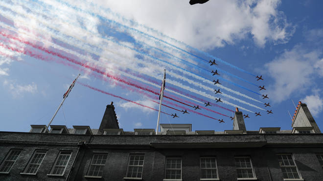 The Red Arrows fly over Downing Street as British Prime Minister Boris Johnson meets with French President Emmanuel Macron