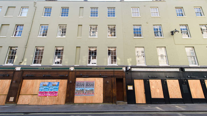 Boarded up shops in London's Soho