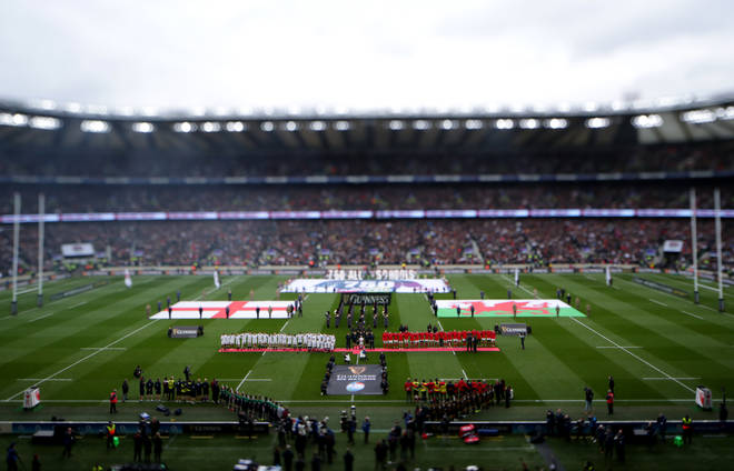 Both teams line-up for the national anthem before the Guinness Six Nations match at Twickenham
