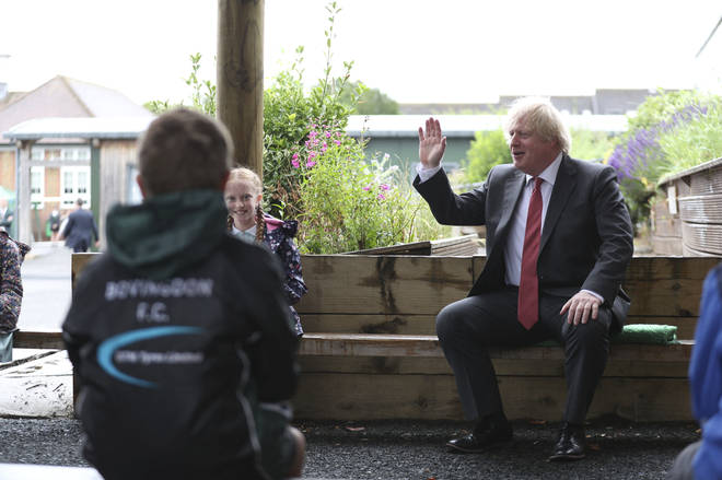 Boris Johnson joins a socially distanced lesson during a visit to Bovingdon Primary School