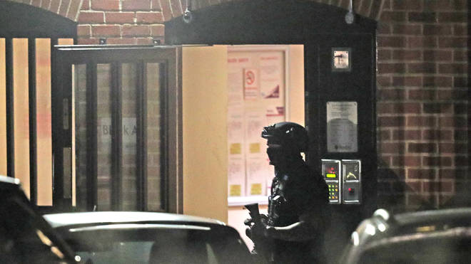 An armed officer is present at a nearby property following the stabbing