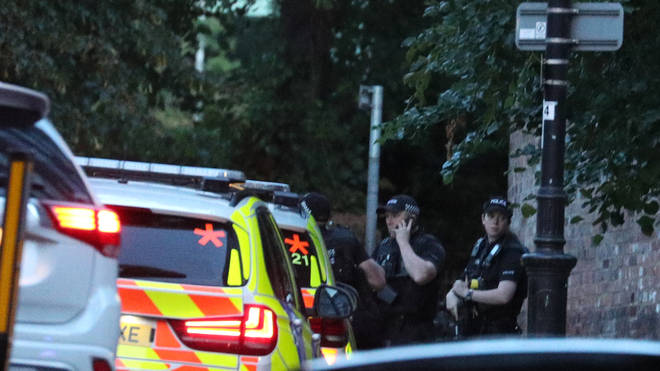 Police seen outside the area where multiple people were stabbed
