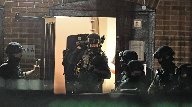 Counter terrorism officers were seen at a nearby address
