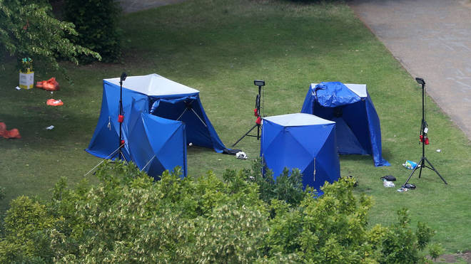 A picture shows police tents and equipment at the scene of the fatal stabbing incident