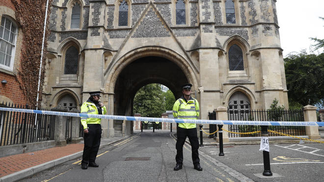Police stand guard at the Abbey gateway of Forbury Gardens, a day after a multiple stabbing attack in the gardens in Reading
