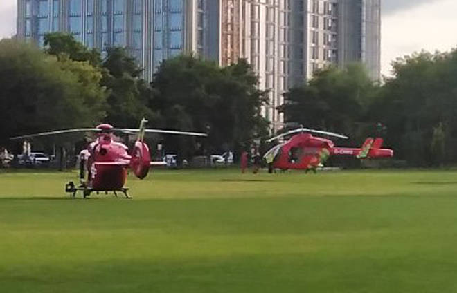 Two air ambulances in Kings Meadow in Reading after an incident at Forbury Gardens in Reading town centre