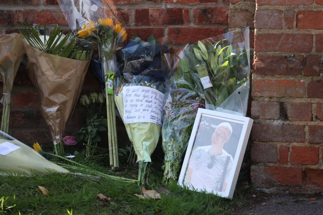 Flowers are laid at the school in memory of James Furlong