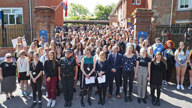 Colleagues and pupils of teacher James Furlong take part in a period of silence at the Holt School, Wokingham