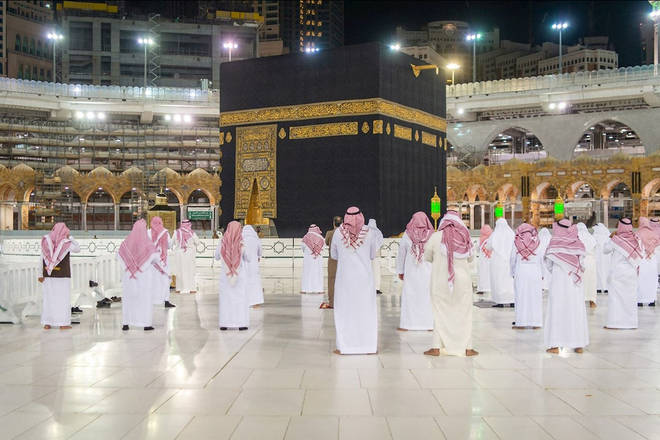 Social distancing during prayer for only few people around the Kaaba inside Mecca's Grand Mosque