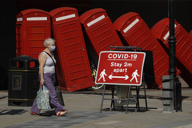 A sign requesting people stay two metres apart to try to reduce the spread of COVID-19 is displayed in Kingston upon Thames