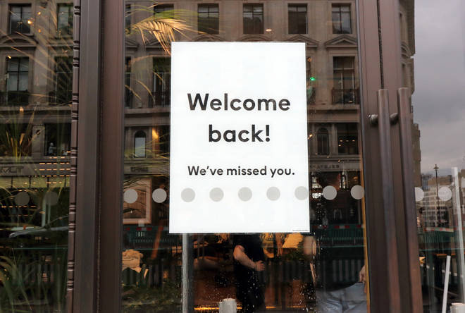 A restaurant welcomes customers back after being closed for almost three months