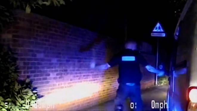 Officers break the driver's window