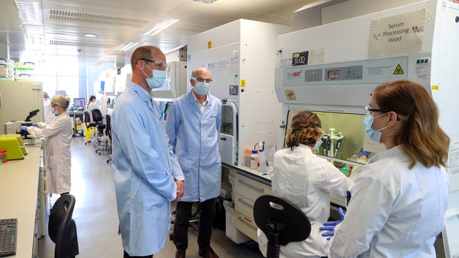 The Duke of Cambridge wears a mask as he meets scientists at the Oxford Vaccine Group's facility