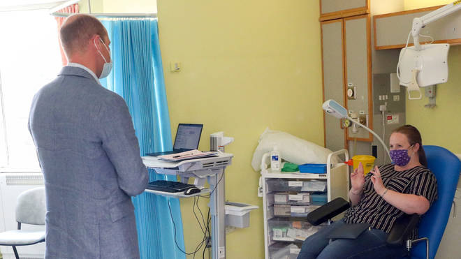 The Duke of Cambridge talks to a patient participating in the Covid-19 vaccine trial