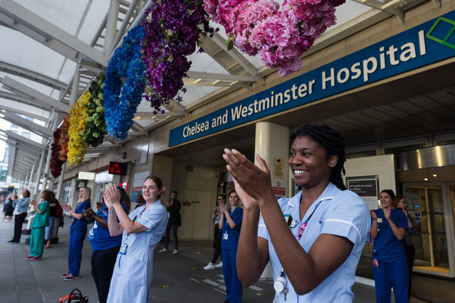 Doctors and nurses clap their hands outside Chelsea and Westminster Hospital during the weekly 'Clap for our Carers'